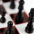 Black chessmen standing - Stock Photo