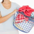 Brunette holding a basket full of laundry — Stock Photo