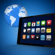 Tablet pc with applications against blue background — Stock Photo