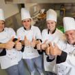Stock Photo: Team of Chef's giving thumbs up