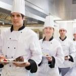Chef's team bringing the dessert — Stock Photo