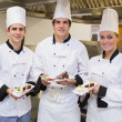Stock Photo: Three Chef's presenting cakes