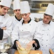 Trainees learning how to prepare dough — Stock Photo