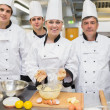 Stock Photo: Smiling pastry class with teacher