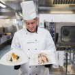 Cook looking at his meals — Stock Photo