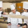 Stock Photo: Three Chef's discussing