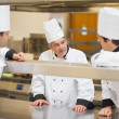Foto de Stock  : Three Chef's discussing