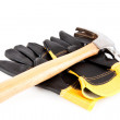 Two builder's gloves and a hammer — Stock Photo