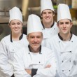 Stock Photo: Smiling team of Chef's