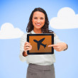 Woman standing holding a tablet pc showing a plane symbol — Stock Photo #23108614