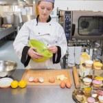 Woman mixing dough in kitchen — Stock Photo #23108880