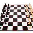 Stock Photo: Chessboard with chess pieces