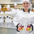 Стоковое фото: Smiling chef presenting salads