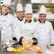 Smiling culinary students with pastry teacher — Stock Photo #23109422