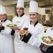 Happy Chef's presenting their salads — Stock Photo #23109442