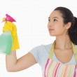 Young woman spraying cleaner — Stock Photo