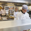 Foto de Stock  : Three Chef's cooking