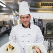 Foto Stock: Chef presenting two dishes