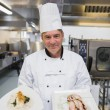 Stockfoto: Chef presenting two dishes