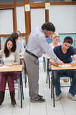 Lecturer helping student — Stock Photo