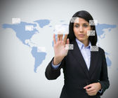Businesswoman selecting email symbol — Stock Photo