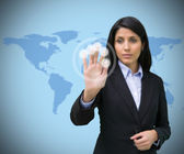 Woman pressing hand to holographic screen — Stock Photo