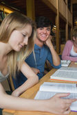 Student looking up from study group — Stock Photo