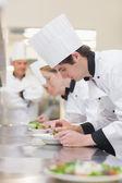 Culinary class preparing salads — Stock Photo