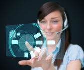 Woman standing while wearing a head set — Stock Photo