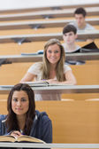 Students sitting looking and smiling — Stok fotoğraf