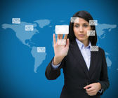 Businesswoman selecting email symbol from many — Stock Photo