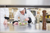 Chef garnishing his salad — Stock Photo
