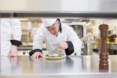 Chef garnishing his salad — Stock Photo