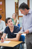 Teacher talking to student — Stock Photo