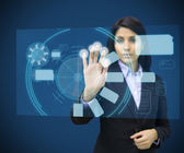 Concentrate woman touching a hologram — Stock Photo