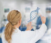 Woman using DNA helix interface — Stock Photo