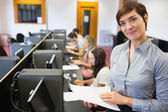 Teacher standing at the computer room — Stock Photo