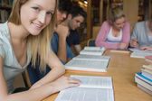 Smiling student with study group — Stock Photo