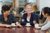 Friends enjoying coffee — Stock Photo