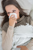 Sick woman on the couch — Stock Photo