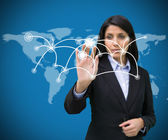 Businesswoman pressing on holographic screen with connecting lin — Stock Photo