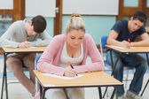 Students in exam hall — Stock Photo