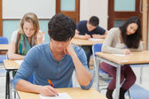 Group of students sitting an exam — Stock Photo
