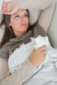 Ill woman lying on sofa — Stock Photo