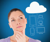 Woman thinking about media devices connecting through cloud comp — Stock Photo