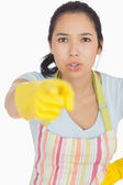 Accusing woman in apron pointing — Stock Photo