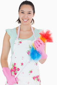 Woman holding a duster — Stock Photo
