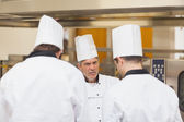 Angry head chef scolding employees — Stock Photo
