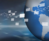 Messages floating past globe — Stock Photo