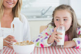 Little girl drinking milk — Stock Photo